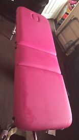 Pink portable massage or tattoo table