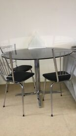 Black glass dining table and 3 chairs