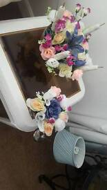 Flower arrangements in glass bowls.