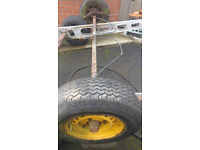 Proper Trailer Axle with brake cables, wheels and springs ideal for making a boat trailer