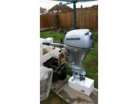 Brand new Honda 15hp standard shaft outboard engine