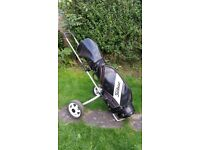 Titleist golf bag and Ben sayers trolley