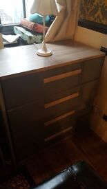John Lewis mix it drawers in grey ash and high gloss drawer fronts.