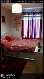 Double divan bed with mattress four drawers and metal headboard BARGAIN
