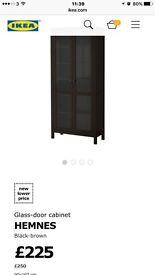 Ikea dark wood wall unit with glass doors