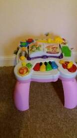 Musical activity table and walker