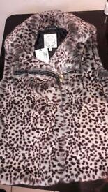 Sleeveless jacket aged 11-12
