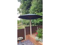 2.7m Green wooden garden parasol.