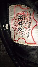 "Leather motorbike jacket, 44"" chest, never used."