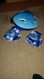 Children's safety helmet with pads