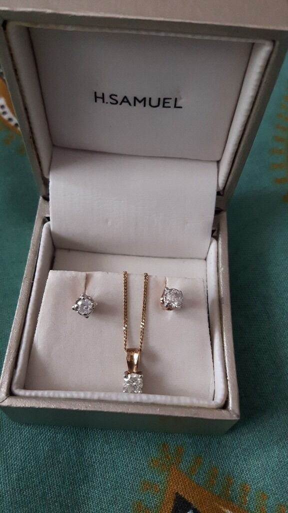 Diamond and Gold Setin Southsea, HampshireGumtree - AS NEW! Stunning, 9ct Yellow Gold with Diamond, necklace and earring Set. Original price £358. Collection from Southsea