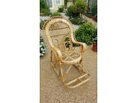 Child's wicker / cane rocking chair in very good condition