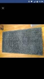2 x blue/grey fluffy rugs