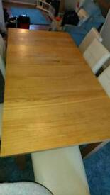 Extendable dining table seats 6-10