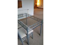 Glass Top tubular grey iron frame Dining Table with 4 chairs