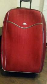 Large red trolley suitcase