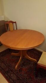 Exyending dining table and four chairs