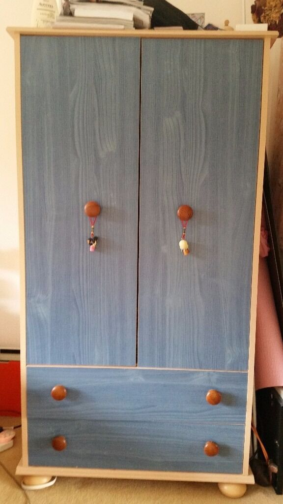 Childrens furniture wardrobein Woking, SurreyGumtree - In very good condition part if a set childrens wardrobe (also look for chest of drawers). In blue and light wood. With 2 drawers at the bottom. From pet and smoke free home. Ready for a colection as is. Sorry cannot transport