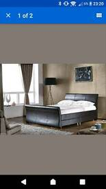 Kingsize faux leather sleigh bed