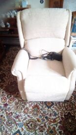 Nearly new electric reclinerchair. Dark cream/light wheat colour
