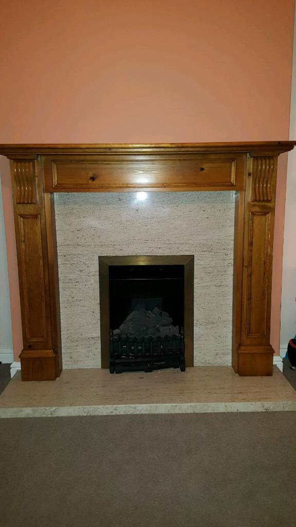 Gas fire with marble surround and half with wooden mantle piece