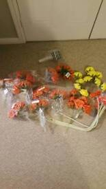 Selection of fake flowers and foam roses. Also a bouquet holder all brand new