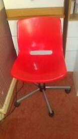 Red plastic spinin chair