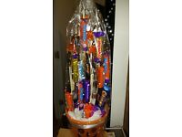 Sweet chocolate bouquets with lights bat or pumpkin in a bucket