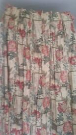 Two sets of matching curtains