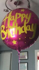 Big pink happy birthday balloon