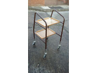 metal framed disabled walker with 2 trays on the front