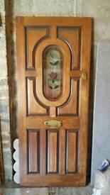 External mahogany door. Decorative triple glazed inset.
