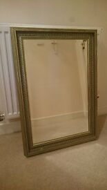 Brass coloured mirror with gilded frame