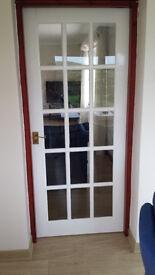 Glazed internal door with 15 panes of glass