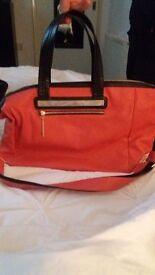 Coral and black Limited bag with strap