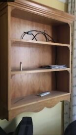 solid made cherry wood or similar shelves with ornate pelmet
