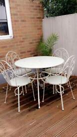 Garden chairs table and parasol