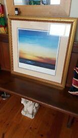large gold framed picture,