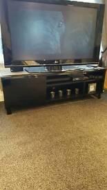 High gloss black TV unit.