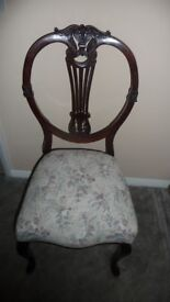 Ornate antique dining chairs