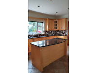 Kitchen with solid wood doors and granite worktops in very good condition
