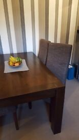Dinning table with chairs.