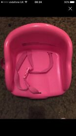Pink plastic booster seat