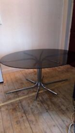 Glass oval table and 4 leather chairs