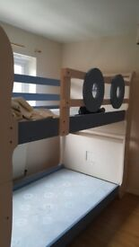 Boat design solid wood bunk bed in excellent condition. selling due to redecoration. Can deliver