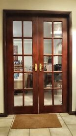 2 pairs of varnished hardwood, glazed with 10 panes of beveled clear glass. Each door 609x 1981x35