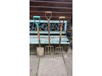 Two old garden forks and spade
