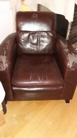 Brown leather tub armchair