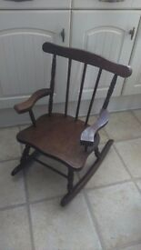 Baby dark wood rocking chair