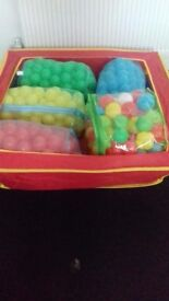 Ball pit and 5 bags of balls